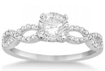 Infinity Engagement Ring / Beautiful and delicate, these infinity engagement ring settings are designed with two bands of micropavé set diamonds intertwined around one another to frame your center stone.  / by Allurez