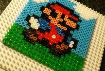 Perler Beads / by Grissette Castro