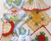 "*CROCHET POTHOLDERS, DISH CLOTHES, COASTERS, ETC. / There are some really pretty potholders in here... some I would just hang for decoration... like the little dresses. Aren't they just the cutest!!!  These can also be used for hot pads. They make wonderful gifts too. Why not find out the color of a friends kitchen and make her some! There doesn't have to be an occasion just a  ""Thinking of You"" gift. / by Janet Marie"