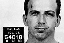 Lee Harvey Oswald / On November 21, 1963, President Kennedy flew to Dallas, Texas for a campaign appearance. The next day Nov 22, Kennedy, along with his wife and Texas governor John Connally, rode through cheering crowds in downtown Dallas in a Lincoln Continental convertible. From an upstairs window of the Texas School Book Depository building, a 24-year-old warehouse worker named Lee Harvey Oswald, fired upon the car, hitting the president twice. Kennedy died at Parkland Memorial Hospital shortly thereafter.  / by Kathy Luty
