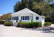 Beachfront Cottage Matthews - Island Inn / Large beach front cottage, 2 bedrooms, 1 bathroom, full kitchen, living room, dining room overlooking Gulf and pool, 1 king bed, 2 twin beds, 1 queen pullout sofa, 47 in flat screen LCD cable TV, DVD/CD player and wifi. / by Island Inn