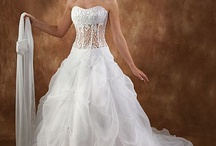 Alot of wonderful wedding dresses / love these amazing dress designs / by Trina Lewis