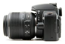 Nikon / by Sherine Candido