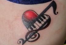 Tattoos & piercings  / by Monica Monroe