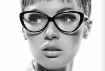 Four eyes / Boys make passes at girls with glasses / by Angel Windley