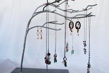 Great ways to store your jewelry / Earring trees, jewelry boxes / by Melissa Williams