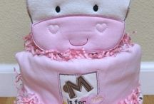 Diaper cakes and creations / by Ivonne Reyes