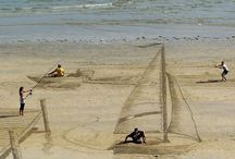 Jamie Harkins Cool Beach Art / Cool Beach Art   New Zealand artist Jamie Harkins and his friends Lucia Lupf, David Rendu, and Constanza Nightingale made these stunning optical illusions and 3D images on the beaches of Mount Maunganui. / by Thomas Benner