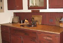 prim bathrooms / by Jody Taylor