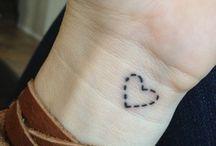 Delicate Tattoos / by Rafaele Damasceno