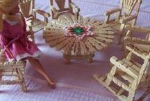 Dolls of many plus their stuff / by Della Bennett