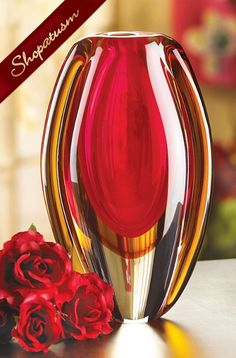 Sunfire Red and Gold Decorative Glass Vase  Add your favorite blooms to this striking glass vase for a breathtakingly beautiful focus piece! Brilliant reds and golds glow in any light, bringing a burst of color to any room. Decorative purposes only. Weight 3.5 lbs. Glass. 5 1/2 inch x 3 inch x 9 inch high. #teamsellit