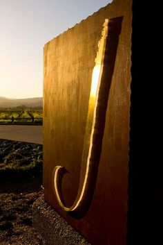 Sun hitting J's Welcome Sign at the Winery.