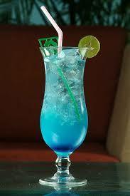 Reason to Live..  1/2 oz Smirnoff® vodka,  1/2 oz melon liqueur,  1/2 oz Malibu® coconut rum,  1/2 oz DeKuyper® Sour Apple Pucker schnapps,  1/2 oz Blue Curacao liqueur,  1/2 oz peach schnapps,  orange juice,   pineapple juice