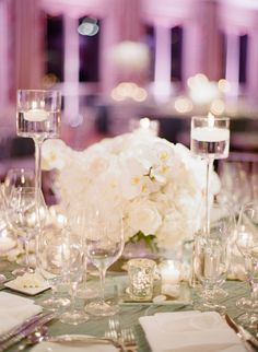 Wedding Centerpieces -- Orchids + Roses + Lots of Sparkling Glassware! See more here: http://www.StyleMePretty.com/2014/03/13/glamorous-ballroom-wedding-in-naples-florida/ Photography: KTMerry.com