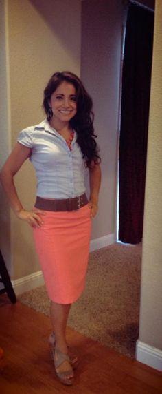 Light blue blouse, light coral pencil skirt, cognac belt, and tan wedges.
