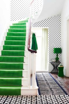 This would be a warm and stimulating entryway for a business. Brought to you by Shoplet.com - everything for your business. geometric prints, polka dots, stairway, color, emerald, black white, kelly green, hallway, stair runners