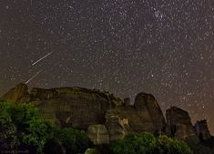 """Perseids over Meteora in central Greece. 2013-08-07. [Image Credit & Copyright: Babak Tafreshi (TWAN)] Two bright meteors in the Perseid meteor shower, whose radiant is the constellation Perseus at the upper right. Meteora is a historic complex of monasteries. Mona Evans, """"Meteor Shower - the Perseids"""", http://www.bellaonline.com/articles/art27461.asp"""