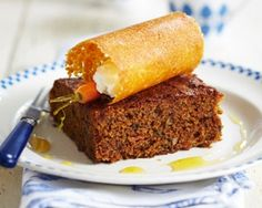 Carrot cake drizzled with orange caramel, topped with sugar and almond cyclinders filled with candied carrot and cream cheese sweet recip, food recipes, carrot cakes, american cake, carrots, jame martin, martin recip, cake recipes, dessert