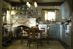 Home Tours: English Cottage from The Holiday.  Love the colors for this kitchen.  Cozy.
