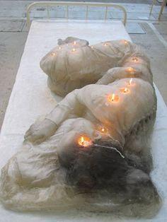Life sized sleeping woman candle