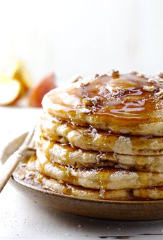 These Old Fashioned Whole Wheat Apple Pancakes are EXTREMELY fluffy and satisfying with apple rings baked right into the pancakes. Yum! | #apple #pancakes