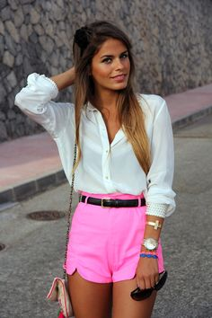 Neon pink shorts, a white blouse, and a black belt make an easy but cute outfit, that accentuates the camel toe.
