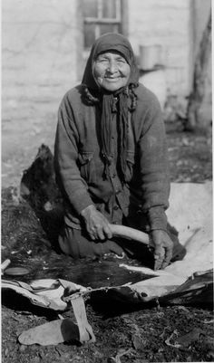 Santee woman scraping hide, 1935  by Marquette University Archives, via Flickr