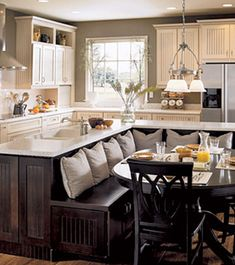 kitchen island + breakfast nook. adorbs.