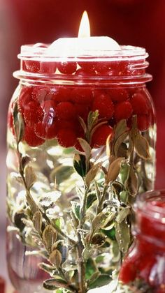 DIY Tutorial ● Illuminating Holiday Jars - Who would have imagined that a humble canning jar could be so artistic? Wash and dry jars and layer the bottom with the greenery of your choice, and then add a handful or two of cranberries. Pour water into the jar, causing the cranberries to float to the top. Insert a floating candle.