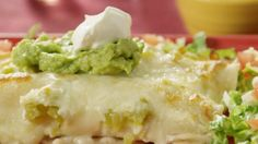Enchanted Sour Cream Chicken Enchiladas   A simple mixture of sour cream and cooked chicken fills corn tortillas, which are rolled and topped with chopped green chilies and Monterey Jack cheese. Quick and easy, these tasty white sauce enchiladas are truly enchanting.