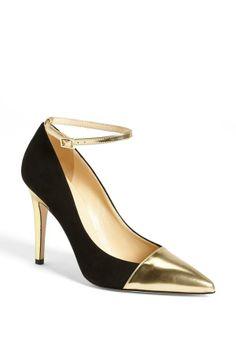 Pretty gold and black pumps.