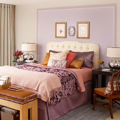 Bedroom makeover: Pretty as a Picture - For a clever color boost, paint a section of the wall framing your bed. Here, a white headboard pops against the soft lavender paint, while pretty wall art fills the open space. The main bedding pieces are swathed in purple to match the block of color on the wall. Unexpected amber brown and shades of pink provide visual breaks in the sea of purple.