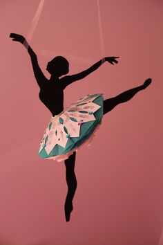 Ballerinas painted black with tutus made out of snowflakes and tissue paper.