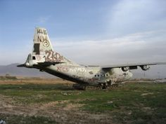 The strange vision of an abandoned plane on top of 2 abandoned tanks at Bagram
