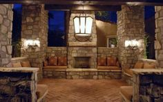 brick outdoor patio and fireplace.