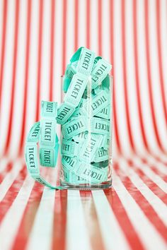 Fill a cylinder glass vases with tickets and place them on your table for decoration at your #circus #baby #shower.