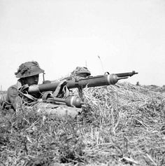 9 August 1944: Canadian infantry attack into the bocage - ''Operation Totalise'' using a PIAT anti tank weapon