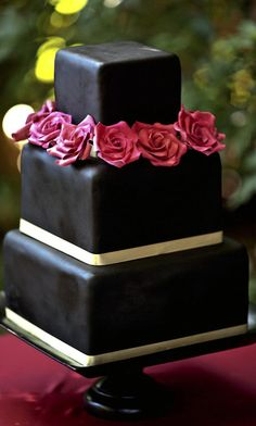 black wedding cake... you could make the flowers bright pink! white cake, pink roses, red roses, fondant recip, wedding cakes, gold accent, groom cake, cake designs, fondant cakes