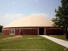 Beggs ISD, Beggs, Oklahoma — A second dome constructed on the Beggs ISD campus is a 112' diameter dome, on a 12' Orion wall, which provides 9 additional classrooms, offices and a student commons area. — www.monolithic.com