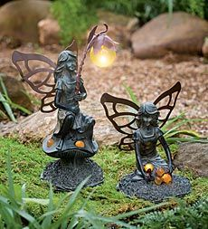 pair-of-solar-powered-glowing-fairy-garden-statues