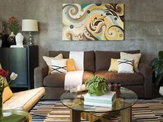 Living Room with Brown Couch colorful art behind, light pillows and throw