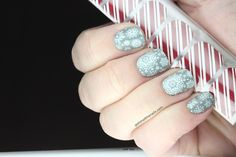White snowflakes over gray base nail strips