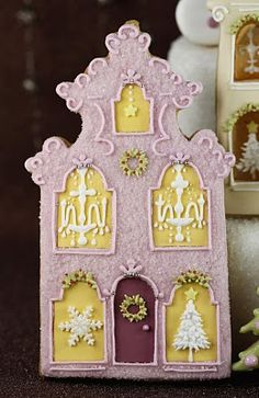 Barcelona Christmas house cookies. Haute Cakes Couture. look at the chandeliers and trees in those windows!