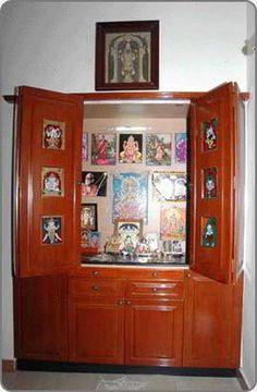 custom cabinet pooja room design. home mandir. lamps. doors. vastu. idols placement.