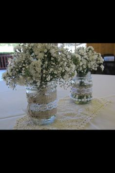 Our easy baby's breath and mason jar centerpieces at out barn wedding.