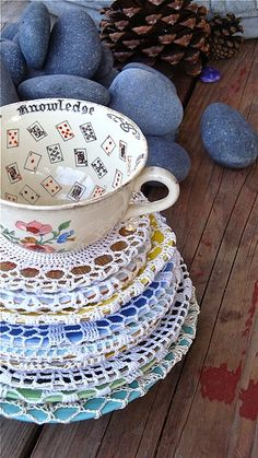 Lovely doily covered tea saucers by resurrection fern.