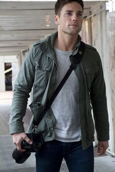 Man with camera strap