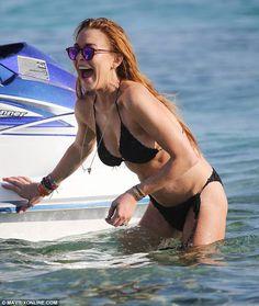 Lindsay Lohan wears a black crochet bikini on vacation in Mykonos (August 2014)