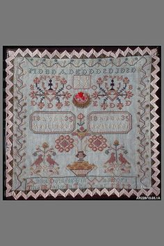 Embroidered Sampler - very different border idea.